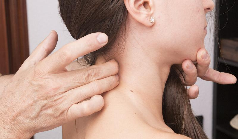 Man Adjusting Woman's Painful Neck